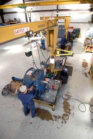 Overhead crane lifting transmission up for work